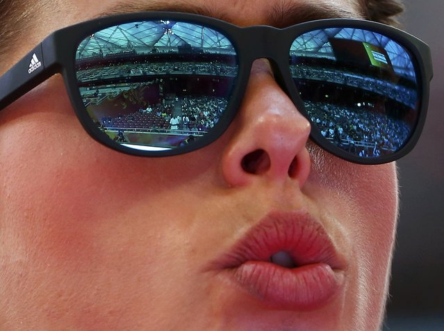 """Blanka Vlasic of Croatia competes in the women's high jump qualifying round with the """"Bird's Nest"""" stadium reflected in her sunglasses during the 15th IAAF World Championships at the National Stadium in Beijing, China August 27, 2015. (Photo by David Gray/Reuters)"""