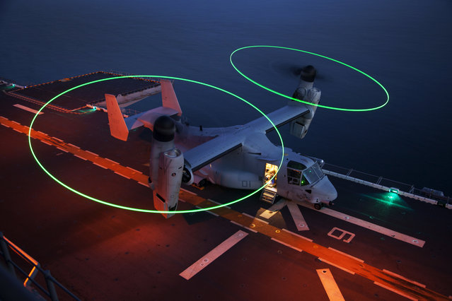 An MV-22B Osprey assigned to Marine Medium Tiltrotor Squadron (VMM) 266 (Reinforced), 26th Marine Expeditionary Unit (MEU), prepares to takeoff during flight operations aboard the USS Kearsarge (LHD 3), while sailing off the coast of Onslow Beach, N.C., January 29, 2013. (Photo by Cpl. Christopher Q. Stone/U.S. Marine Corps photo)