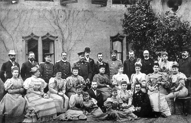Members of several European Royal families outside Rosenau Castle during celebrations for the betrothal of  Tsarevich Nicholas of Russia (soon to be Tsar Nicholas II) and Princess Alix of Hesse (back row left to right); Prince Henry of Battenberg, Prince Philip of Coburg, Prince Ferdinand of Romania (later King Ferdinand), Prince Henry of Prussia, Grand Duke Paul of Russia, The Duke of Coburg, Tsarevich Nicholas of Russia,  William II of Germany and Prussia, Grand Duke Vladimir, Duke of Connaught, Prince Louis of Battenberg, Alexendra of Coburg and The Prince of Wales (later King Edward VII). Original Artwork: Photo by J Russell & Sons, 1894.