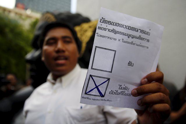 "An opposition student holds a mock ballot with the option ""No"" seletcted during a protest againts the military-backed draft constitution in Bangkok, Thailand September 5, 2015. (Photo by Jorge Silva/Reuters)"