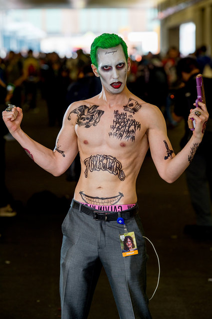 A fan cosplays as the Joker from Suicide Squad and Batman during the 2017 New York Comic Con, Day 4 on October 8, 2017 in New York City. (Photo by Roy Rochlin/WireImage)