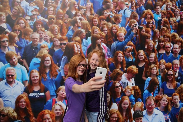 "Two girls with red hair take a selfie while taking part in the ""Roodharigendag"" (Redhead Day) in Breda. (Photo by Arie Kievit/EPA)"