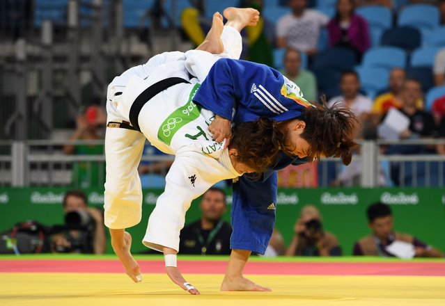 Italy's Valentina Moscatt (white) competes with Vietnam's Ngoc Tu Van during their women's -48kg judo contest match of the Rio 2016 Olympic Games in Rio de Janeiro on August 6, 2016. (Photo by Toshifumi Kitamura/AFP Photo)