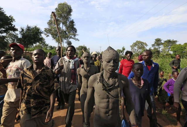 Bukusu villagers escort youths as part of a circumcision ritual in Kenya's western region of Bungoma August 9, 2014. (Photo by Noor Khamis/Reuters)