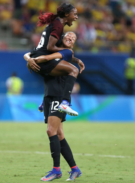 United States' Crystal Dunn, top, celebrates scoring her side's first goal with teammate Christen Press during a group G match of the women's Olympic football tournament between Colombia and United States at the Arena Amazonia stadium in Manaus, Brazil, Tuesday, August 9, 2016. The game ended in a 2-2 draw. (Photo by Michael Dantas/AP Photo)