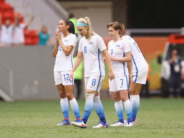 Christen Press #12, Julie Johnston #8, Meghan Klingenberg #7 and Tobin Heath #17 of United States react after their 1-1 (3-4 PSO) loss to Sweden during the Women's Football Quarterfinal match at Mane Garrincha Stadium on Day 7 of the Rio 2016 Olympic Games on August 12, 2016 in Brasilia, Brazil. (Photo by Celso Junior/Getty Images)