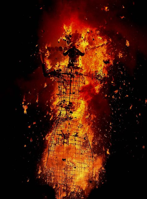 An effigy of the demon king Ravana burns in Jammu, India October 24, 2012. (Photo by Channi Anand/Associated Press)
