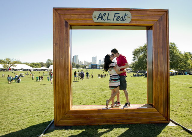 Christine Choi kisses her fiance Kyle Ruiz at the Austin City Limits Music Festival in Zilker Park, Friday, October 3, 2014, in Austin, Texas. (Photo by Jay Janner/AP Photo/Austin American-Statesman)