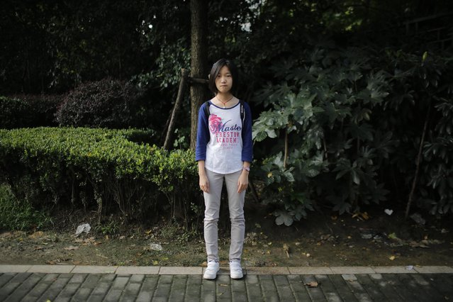 "Dai Jingting, who was born in 2001, poses for a photograph in Shanghai September 20, 2014. Jingting said she would like siblings ""because it would be boring for me to stay at home alone"". (Photo by Carlos Barria/Reuters)"