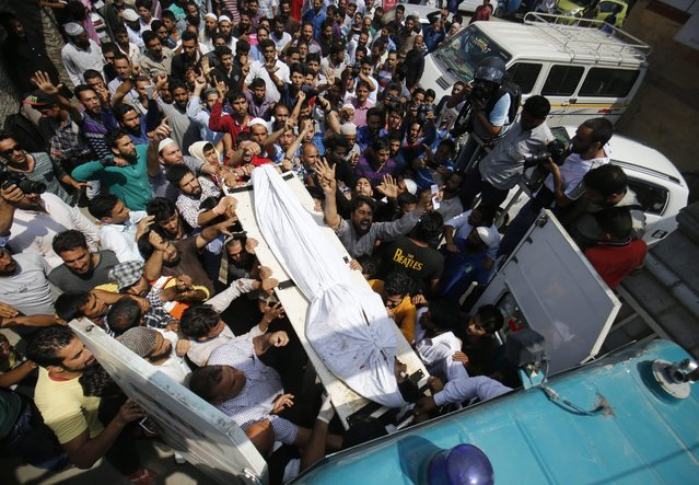 Kashmiri Muslims carry the body of Amir Gul in the compound of a local hospital in Srinagar, the summer capital of Indian Kashmir, 24 August 2016. According to media reports, a young man named Amir Gul Mir was killed in fresh clashes in Pulwama, south of Srinagar, during which around a dozen youth were injured. Eight of the injured were taken to Srinagar hospitals for treatment, local newspaper reported. Over 65 persons have been killed and more than 7000 injured during the past month and a half following the protests over the killing of Hizb-ul-Mujahideen commander, Burhan Muzaffar Wani and his two associates in a gunfight on 08 July 2016. (Photo by Farooq Khan/EPA)