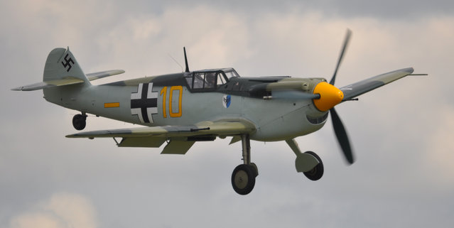 Messerschmitt Bf 109 – Flying Legends Airshow Duxford 2012. The Messerschmitt Bf 109, often called Me 109, was a German World War II fighter aircraft designed by Willy Messerschmitt and Robert Lusser during the early to mid 1930s. It was one of the first truly modern fighters of the era, including such features as all-metal monocoque construction, a closed canopy, a retractable landing gear, and was powered by a liquid-cooled, inverted-V12 aero engine. The Bf 109 first saw operational service during the Spanish Civil War and was still in service at the dawn of the jet age at the end of World War II, during which time it was the backbone of the Luftwaffe's fighter force. From the end of 1941 the Bf 109 was supplemented by the Focke-Wulf Fw 190. (Rob Lovesey)