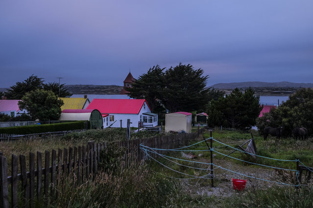 Dusk settles just off the main street of the capital near the Stanley Harbour on Friday, February 12, 2016, in Stanley, Falkland Islands.  The town is home to a around 2,000 of the sparkly populated islands' nearly 3,000 people. (Photo by Jahi Chikwendiu/The Washington Post)