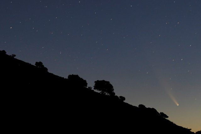 """The Comet C/2020 or """"Neowise"""" is seen in the sky from the """"Puerto del Viento"""" mountain pass at dawn in Ronda, southern Spain, July 15, 2020. (Photo by Jon Nazca/Reuters)"""