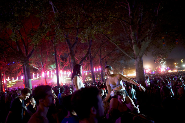 Revelers dance to Coldplay during the fifth annual Made in America Music Festival in Philadelphia, Pennsylvania September 4, 2016. (Photo by Mark Makela/Reuters)