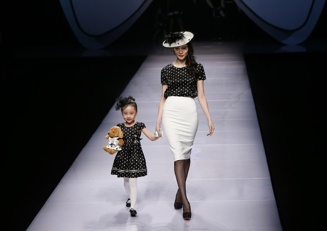 An adult and a child model present creations at Dong Wenmei T100 Children's Collection during China Fashion Week in Beijing October 29, 2014. (Photo by Kim Kyung-Hoon/Reuters)