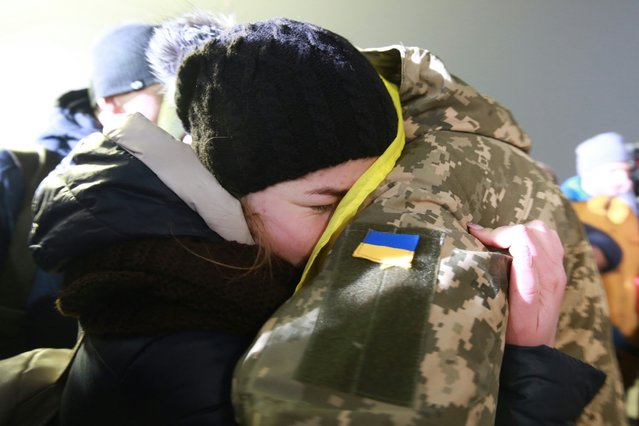 People celebrate during the arrival of released soldiers of the Ukrainian Armed Forces at the Boryspil (Borispol) Airport; 73 soldiers of the Ukrainian Armed Forces have been released in exchange for 233 fighters of the Donetsk People' s Republic and the Lugansk People' s Republic at Mayorsk crossing near Gorlovka (Horlivka) in east Ukraine as part of an agreement proposed by Ukrainian politician Viktor Medvedchuk who visited Russia in November 2017. (Photo by Serhiy Nuzhnenko/RFE/RL)