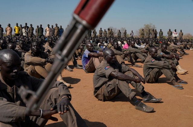 South Sudan People's Defence Forces (SSPDF), South Sudan Opposition Alliance (SSOA), and The Sudan People's Liberation Movement in Opposition (SPLM-IO) soldiers gather at the training site for the joint force to protect VIPs in Gorom outside Juba, South Sudan on February 17, 2020. (Photo by Andreea Campeanu/Reuters)
