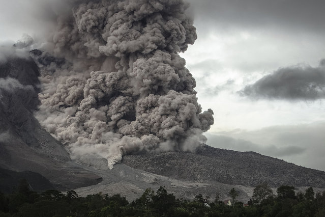 Giant ash clouds erupt from Mount Sinabung volcano, on November 03, 2014 in Karo district, North Sumatra, Indonesia. The volcano, which has been active since September 2013, erupted in February, killing at least 15 people and forcing thousands to evacuate their homes. There have been no casualties reported from the latest eruption. (Photo by Y. T. Haryono/Barcroft Media)