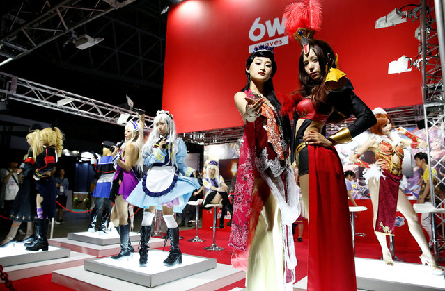 Promotional staff wearing the costumes of game publisher 6waves' game characters pose on a stage at Tokyo Game Show 2016 in Makuhari, east of Tokyo, Japan, September 15, 2016. (Photo by Kim Kyung-Hoon/Reuters)
