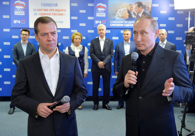 Russian President Vladimir Putin and Prime Minister and Chairman of the United Russia party Dmitry Medvedev visit the party's campaign headquarters following a parliamentary election in Moscow, Russia, September 18, 2016. (Photo by Alexei Druzhinin/Reuters/Sputnik/Kremlin)