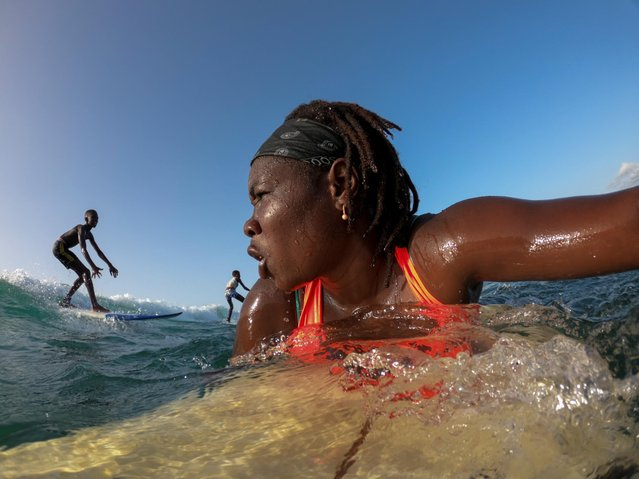 "Khadjou Sambe, 25, surfs off the coast of Ngor, Dakar, Senegal, August 18, 2020. Growing up in the coastal capital of Dakar, Sambe never saw a Black woman surfing the Atlantic swells. As Senegal's first female professional surfer, Sambe is now inspiring the next generation to defy cultural norms and take to the waves as a surfing coach for local girls. ""When I am in the water I feel something extraordinary, something special in my heart"", Sambe said. (Photo by Zohra Bensemra/Reuters)"