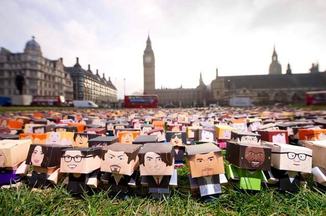 Thousands of paper protestors, including paper versions of celebrities, positioned on Parliament Square in central London this morning as part of Fairtrade Fortnight Go Further campaign, which calls for David Cameron to do more for smallholder farmers ahead of the G8 summit which takes place in June. (Photo by Matt Crossick/PA Wire)
