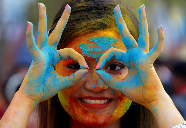 A student of Rabindra Bharati University, with her face smeared in coloured powder, poses during celebrations for Holi inside the university campus in Kolkata, India, February 26, 2018. (Photo by Rupak De Chowdhuri/Reuters)
