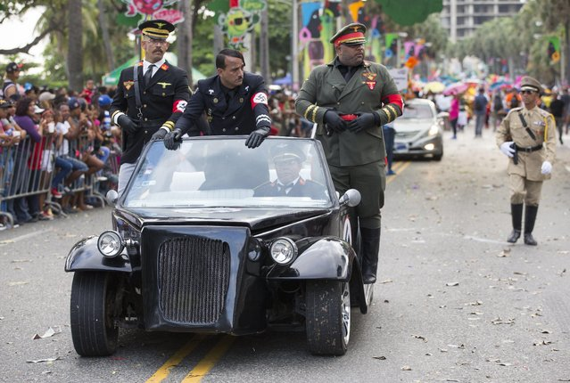 People wearing costumes resembling Adolf Hitler and Nazi officials participate during the 2018 National Carnival Parade on the boardwalk of Santo Domingo, Dominican Republic, 04 March 2018. (Photo by Orlando Barria/EPA/EFE)