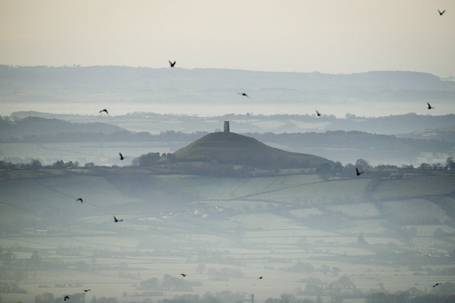 This December 19, 2017 file photo shows Glastonbury Tor in Glastonbury, England, which is cared for by the National Trust. Britain's National Trust which looks after hundreds of the country's well-loved historic sites, published a report Tuesday Sept. 22, 2020, said 93 of its sites have connections with aspects of the global slave trade or Britain's colonial history. Glastonbury Tor is shown to have links to successful compensation claims as a result of the abolition of slavery,. (Photo by Ben Birchall/PA Wire via AP Photo/File)