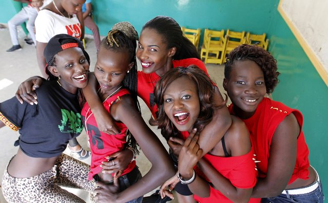 "Models pose for a photograph backstage before the Miss Koch beauty pageant, titled ""Getting to Zero Teenage Pregnancy"", at the Korogocho slums in Nairobi, December 6, 2014. The winner of the pageant, Miss Koch Kenya, will represent and lead the non-governmental organization to encourage youths in slums to overcome challenges such as poverty, crime, drug and sexual abuse, according to organisers. (Photo by Thomas Mukoya/Reuters)"