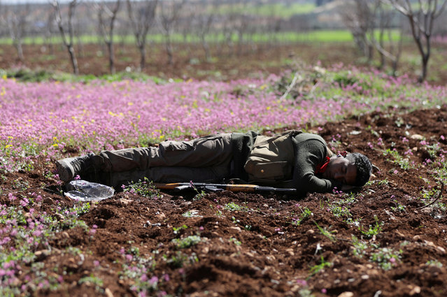A Turkish-backed Free Syrian Army fighter is seen resting in eastern Afrin, Syria March 9, 2018. (Photo by Khalil Ashawi/Reuters)