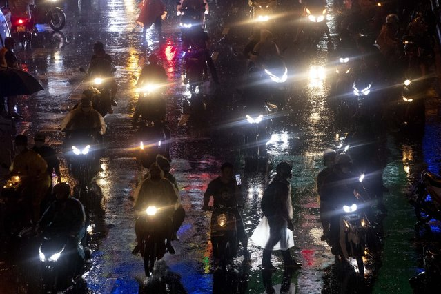 Pro-democracy demonstrators travel on motorcycles after ending their protest for the day in Bangkok, Thailand, Friday, October 16, 2020. (Photo by Gemunu Amarasinghe/AP Photo)