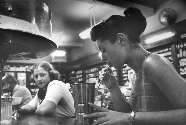 """""""Hungry at drugstore after a day's work earning money for nursing school, Dorothy envies slim girl's milkshake, orders lemonade without sugar for herself"""". (Photo by Martha Holmes/Time & Life Pictures)"""