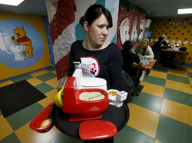 A waitress serves an order at Crazy Toilet Cafe in central Moscow, Russia October 30, 2015. (Photo by Sergei Karpukhin/Reuters)