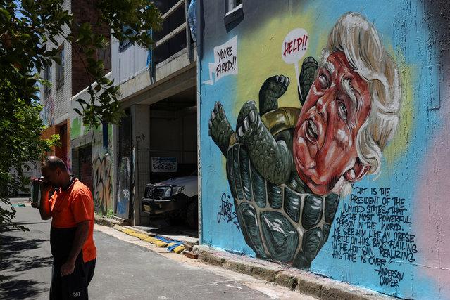 A mural depicting the US president, Donald Trump, by Australian artist Scott Marsh references commentary from CNN's Anderson Cooper in Sydney, Australia on November 9, 2020. (Photo by Loren Elliott/Reuters)