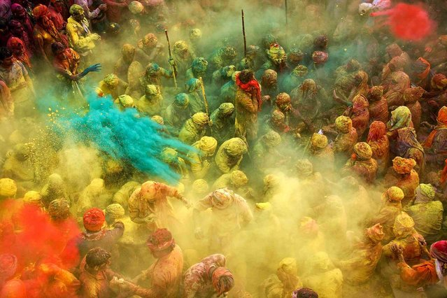Holi – the festival of colors – is undoubtedly the most fun-filled and boisterous of Hindu festivals. It's an occasion that brings in unadulterated joy and mirth, fun and play, music and dance, and, of course, lots of bright colors! (Photo by Anurag Kumar/2013 Sony World Photography Awards)