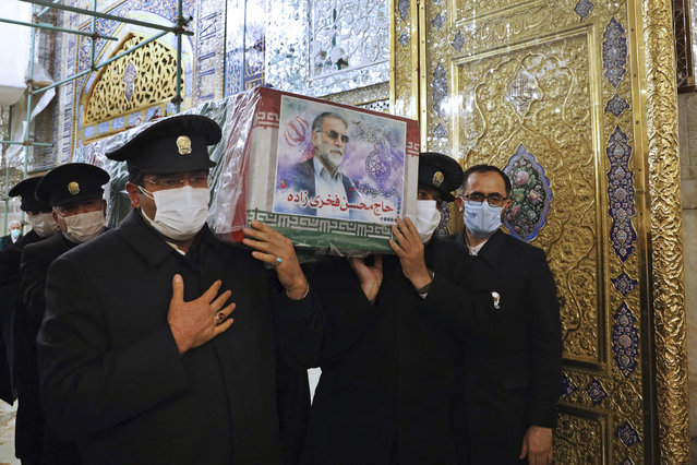 In this picture released by the Iranian Defense Ministry and taken on Saturday, November 28, 2020, caretakers from the Imam Reza holy shrine, carry the flag draped coffin of Mohsen Fakhrizadeh, an Iranian scientist linked to the country's disbanded military nuclear program, who was killed on Friday, during a funeral ceremony in the northeastern city of Mashhad, Iran. An opinion piece published by a hard-line Iranian newspaper has suggested that Iran must attack the Israeli port city of Haifa if Israel carried out the killing of a scientist. (Photo by Iranian Defense Ministry via AP Photo)