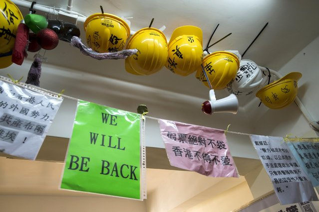 Helmets and posters of the pro-democracy umbrella movement are hang from a ceiling of a Occupy-themed guesthouse in Hong Kong December 30, 2014. (Photo by Tyrone Siu/Reuters)