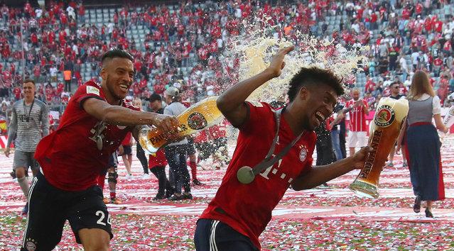 Bayern Munich's Corentin Tolisso and Kingsley Coman as they celebrate winning the Bundesliga title after the German Soccer Bundesliga match between FC Bayern Munich and VfB Stuttgart in Munich, Germany, Saturday, May 12, 2018. (Photo by Michael Dalder/Reuters)