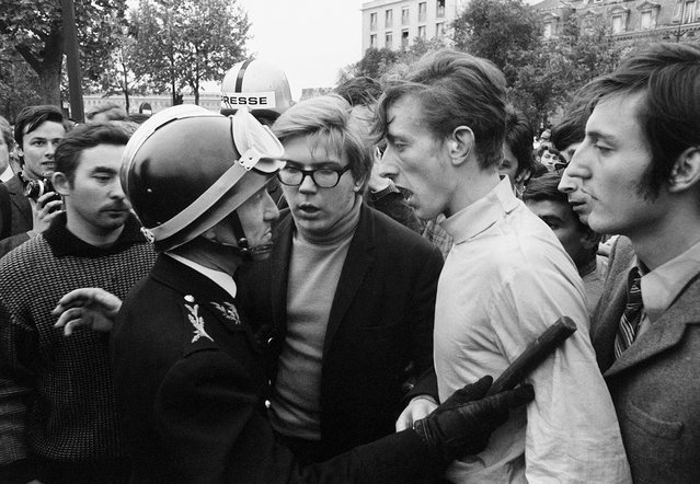 On the Quai d'Orsay at the Pont des Invalides, (the bridge was closed by police), students come face-to-face with a baton wielding riot policeman during a march from Place Denfert-Rochereau towards the Avenue des Champs-Elysees in Paris, France on May 7, 1968. (Photo by Gökşin Sipahioğlu/SIPA Press)