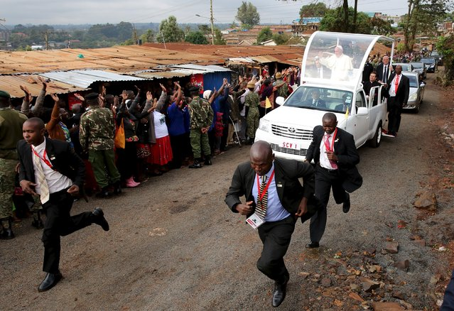 Pope Francis waves as he arrives at the Kangemi slums on the outskirts of Kenya's capital Nairobi, November 27, 2015. (Photo by Goran Tomasevic/Reuters)