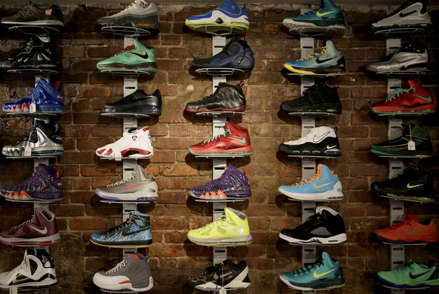 In this January 12, 2015 photo, a wall of collectable sneakers are displayed at Sneaker Pawn in the Harlem section of New York. Basketball sneakers can re-sell for hundreds of dollars, depending on the model, the size of the production run and how easy it is to find a pair in good condition. (Photo by Seth Wenig/AP Photo)