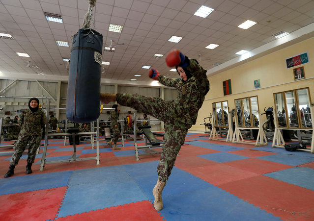 Fatima Rezai, 21, a female officer from the Afghan National Army (ANA) practices with a punch bag during an exercise session at at the Kabul Military Training Centre (KMTC) in Kabul, Afghanistan October 23, 2016. (Photo by Mohammad Ismail/Reuters)