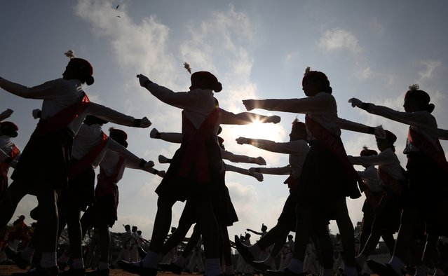 Indian students march during a full dress rehearsal of the Republic Day parade in Bangalore, India, Saturday, January 24, 2015. (Photo by Aijaz Rahi/AP Photo)