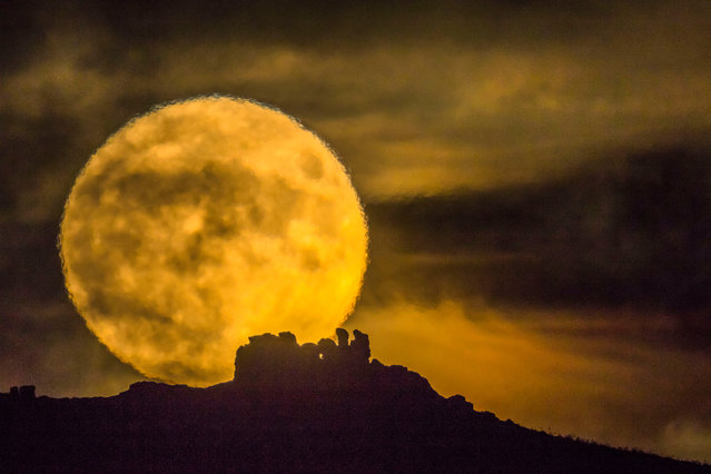 Photographer Andrew Fusek Peters captured a striking image of the moon appearing enormous as it rose over Caer Caradoc in Shropshire, England on November 14, 2016. (Photo by Andrew Fusek Peters/Mercury Press)