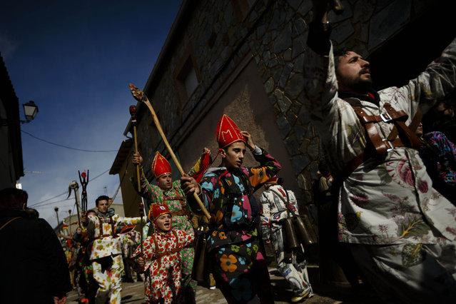 "Members of the Endiablada brotherhood dance during the ""Endiablada"" traditional festival in Almonacid Del Marquesado, Spain, Tuesday, February 3, 2015. (Photo by Daniel Ochoa de Olza/AP Photo)"