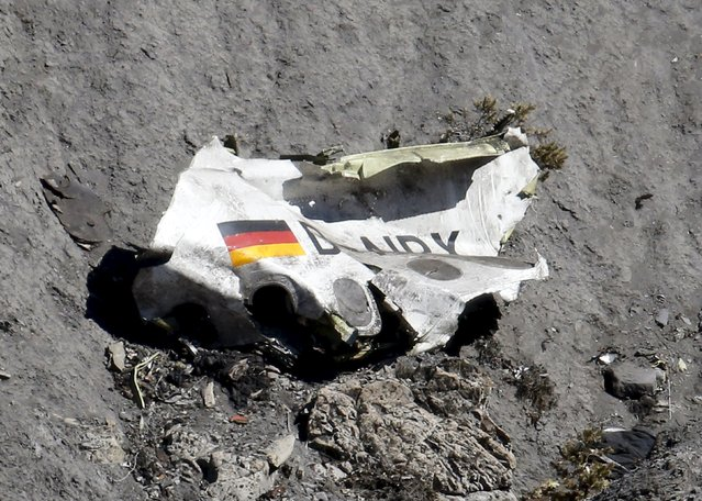 Wreckage of the Airbus A320 is seen at the site of the crash, near Seyne-les-Alpes, in the French Alps, France, March 26, 2015. (Photo by Emmanuel Foudrot/Reuters)