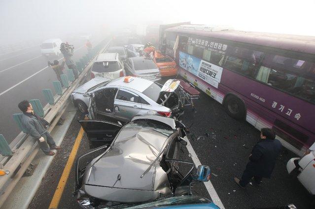 Damaged vehicles sit on Yeongjong Bridge in Incheon, South Korea, Wednesday, February 11, 2015. (Photo by Suh Myung-gon/AP Photo/Yonhap)