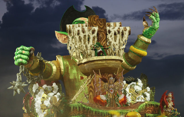 Dancers from the Nene de Vila Matilde samba school perform on a float during a carnival parade in Sao Paulo, Brazil, Saturday, February 14, 2015. (Photo by Andre Penner/AP Photo)