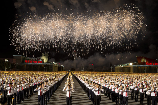 North Korean students take part in a torch light march held in conjunction with the 70th anniversary of North Korea's founding day celebrations in Pyongyang, North Korea, Monday, September 10, 2018. (Photo by Ng Han Guan/AP Photo)